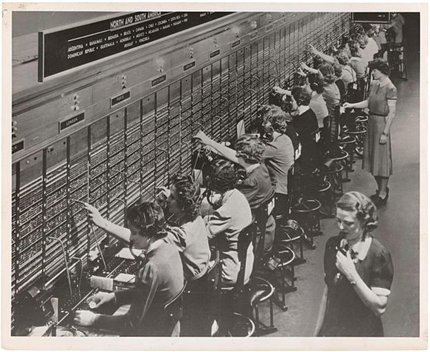 In many ways, a switch functions a lot like these telephone operators making connections between two points and then making new connections.